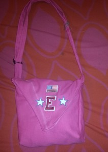 This is my daughter's purse that I made.  We were looking for a Hello Kitty applique to put on the front, but when we didn't find it, she asked for the American flag, an E and two stars. She's more patriotic than I knew. :)