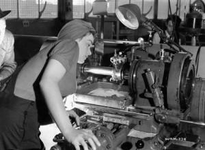 A World War II gunsmith working hard. (source: public domain photo via WikiCommons)